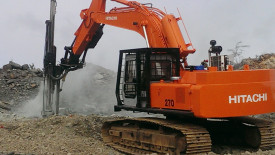 Hitachi 270 with drill rig